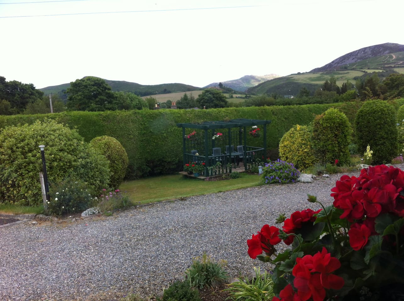 View from your sitting room window into our garden and also seating area where you can relax after a day of sightseeing