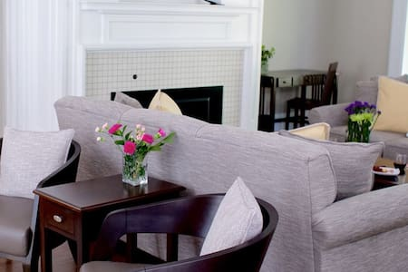 The living room offers a variety of seating areas and writing desks for guests to use at any time.  There is a large screen television, gas fireplace and chest of popular games for entertainment.  Just off the living room guests have access to a large furnished porch with views of the east end of Cornell College campus.