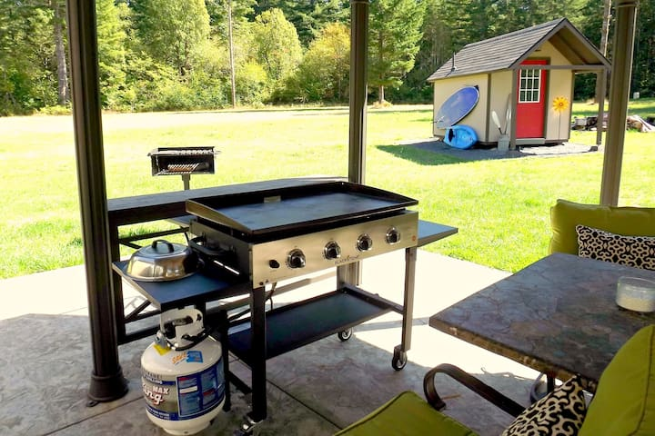 Great Griddle for all meals and Paddle Board Hanging on bath house.