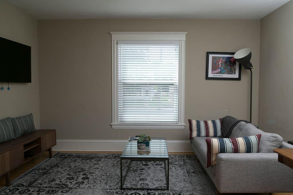 Living room w/ local artwork & West Elm sofa!