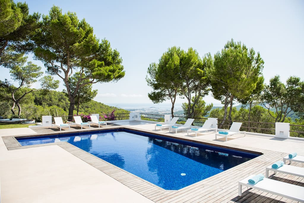 Pool view with sea view and of Ibiza town