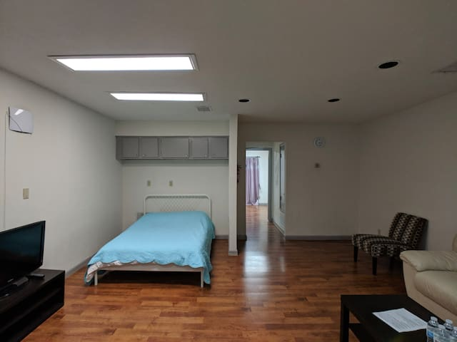 Living room with view of the hallway to the bedroom