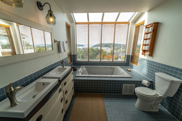Master bath, with double jetted tub, walk in shower and bay window with westerly view.