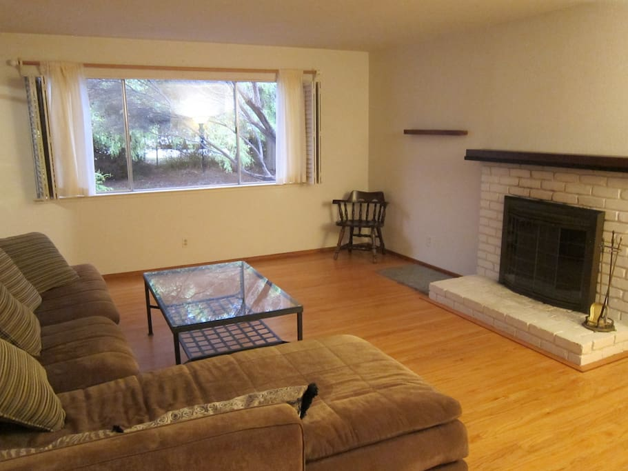 Family room with working fireplace.