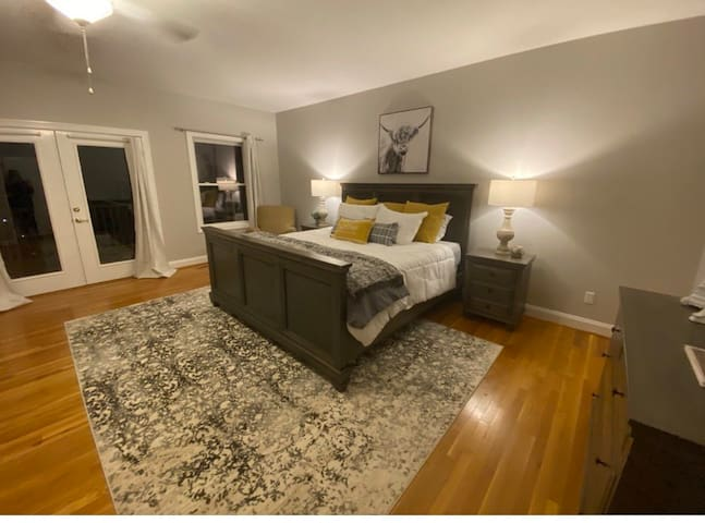 Huge master bedroom with attached bathroom, opens up to the large back deck. Beautiful lake views.