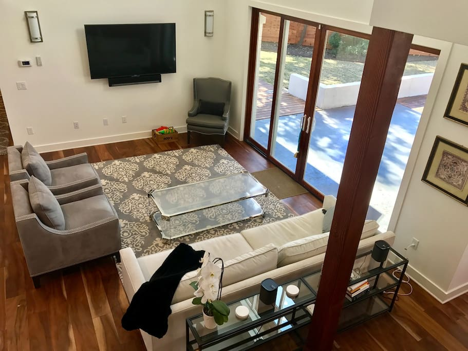 """Main living room with 65"""" TV & Surround TV"""
