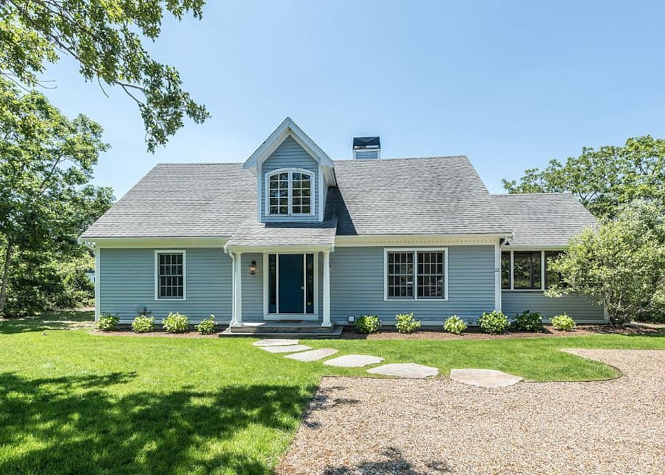 Inviting and sunny cape-style home with great screened in porch to the right