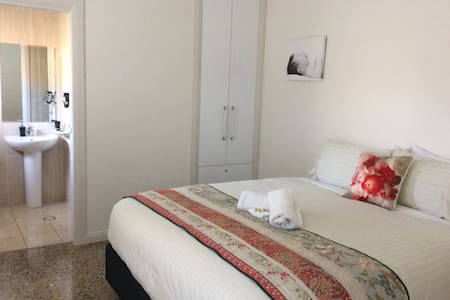 Room 1  - Can be a king room or split to two singles (with notice given). As with all our rooms, it includes a private ensuite and TV.