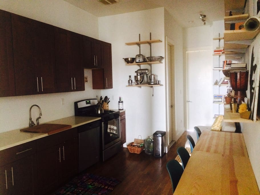 Kitchen & common area.  You may use all dishes, (NON cast iron) cookware, and kitchen tools. Appliances NOT accessible. BREAKFAST, TEA, COFFEE ONLY COMES WITH SHORT TERM GUEST PRICE (not monthly). Tables may be used as work space if work space #1 in alternate common area is occupied.