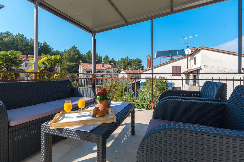 sunny terrace with a BBQ