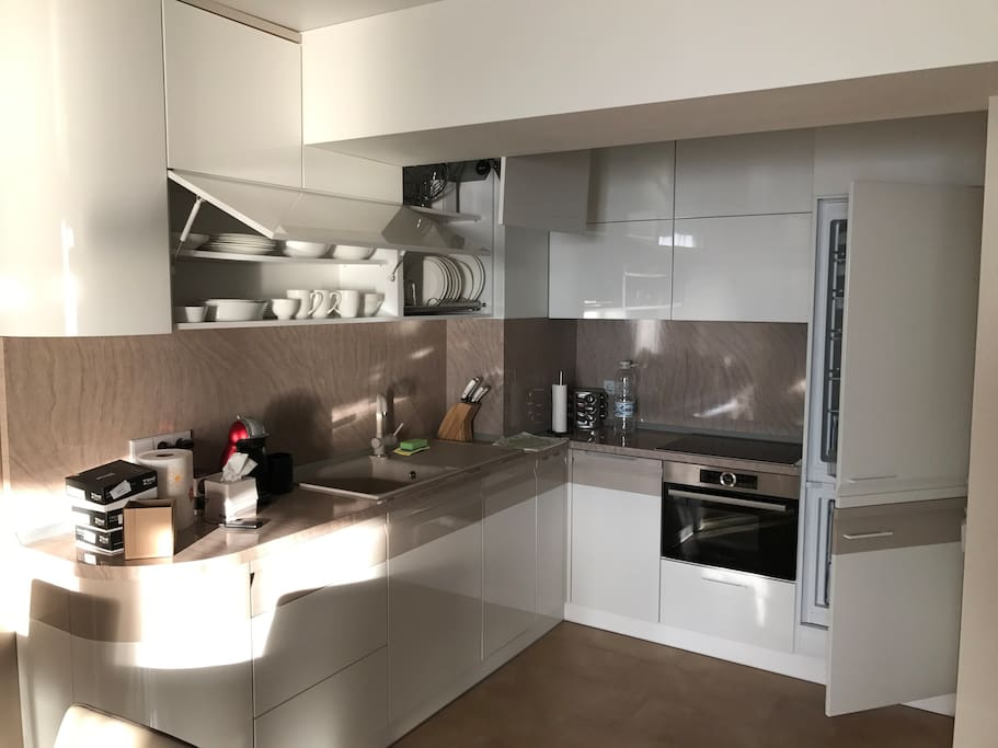 The open kitchen fully equipped for cooking
