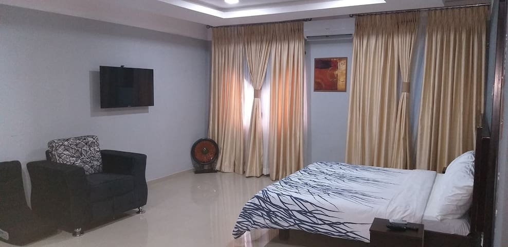 3 shades of curtains. Can alter day light or make it completely pitch dark for day sleep. TV is 43 inch cable satellite with 42 channels..