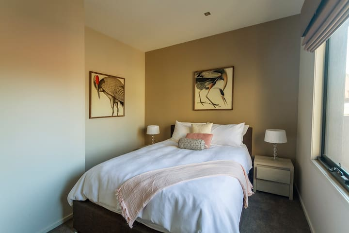 Airconditioned 2nd bedroom with wardrobe, big windows, Wifi. With new and top quality foam mattress with goose topper.