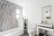 Can you tell what's missing from this bathroom in Bungalow Four? Right, a shower curtain. Go ahead and drip all over the concrete floors. You won't hurt 'em a bit.