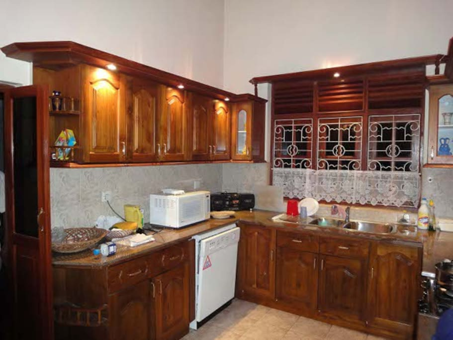 Microwave, dish washer, hot and cold water, oven and hob.