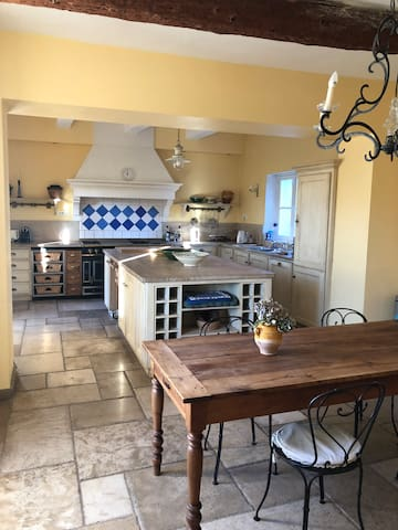 Spacious kitchen with  La Cornue stove and  table for 8