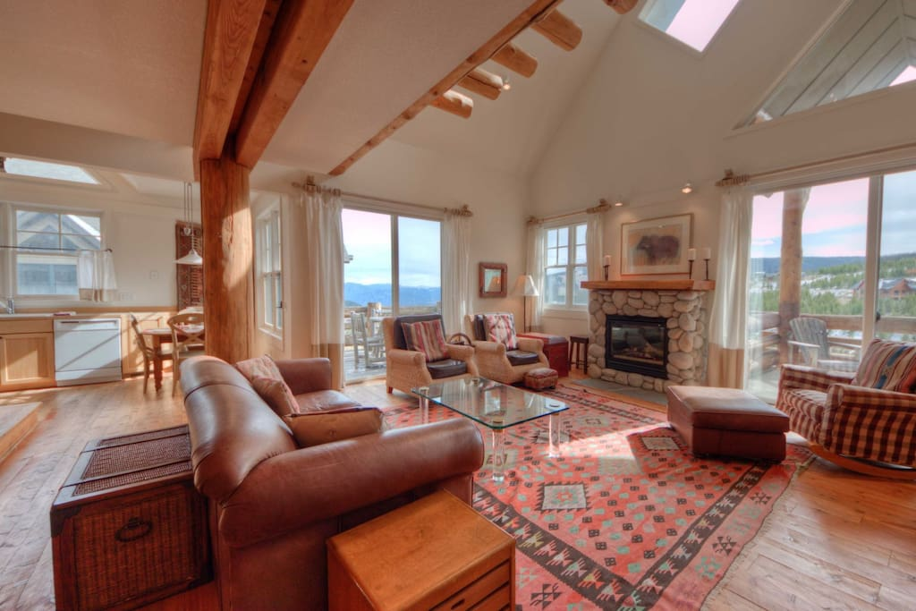 Large open living room with flat screen TV, Lone Peak views, and plenty of seating
