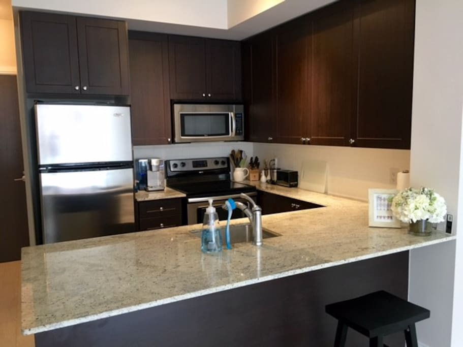 Fully equipped kitchen with stainless steel appliances, dishwasher and most essential items.