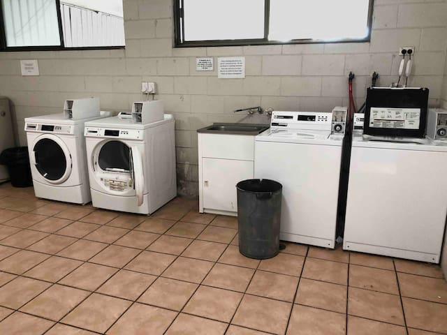 Laundry located near unit 33 as well as near reception level
