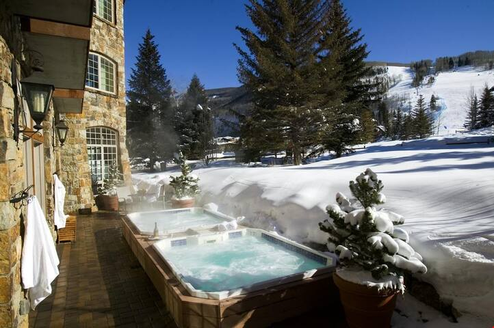 Village View Room | Outdoor hot tub with Mountain Views + Fitness Room
