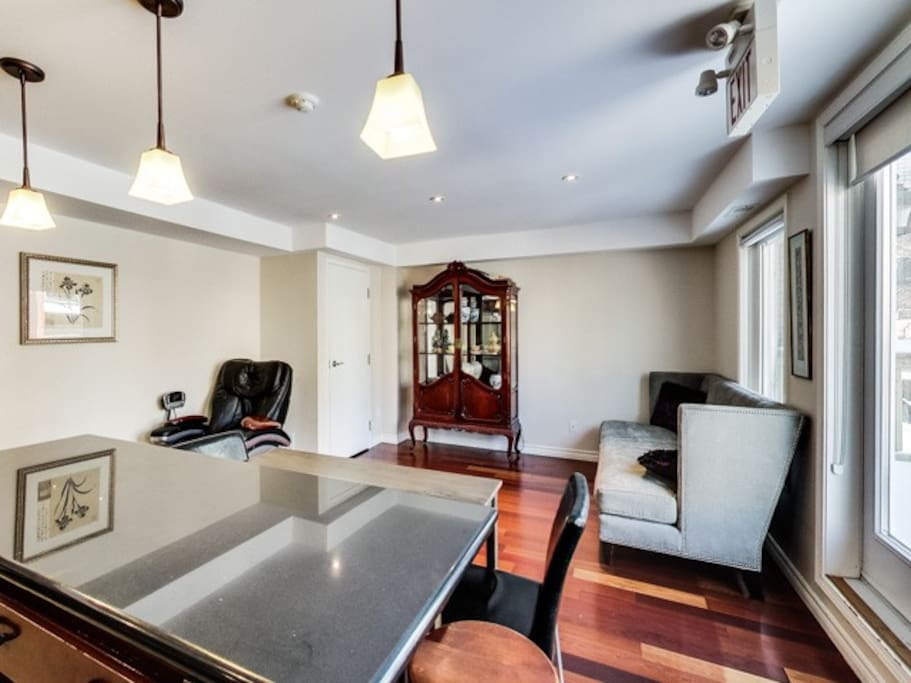 Large bright living room with access to a large deck.