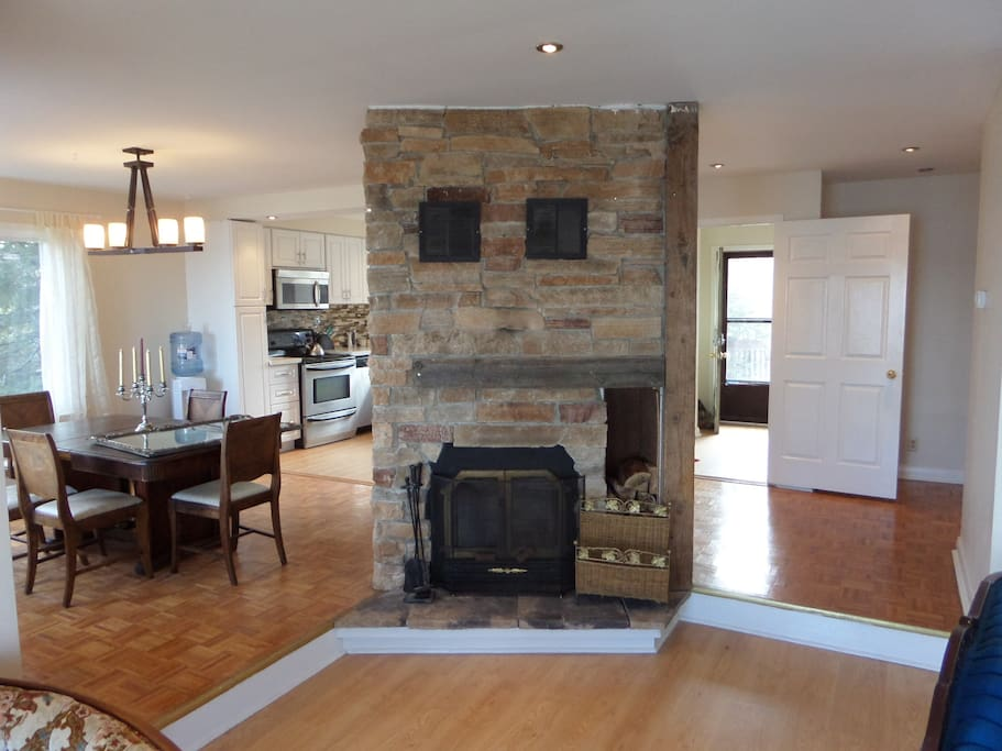 Open concept, newly renovated with original rustic touch preserved. Wood fireplace
