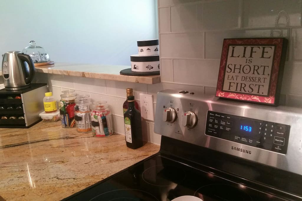 Kitchen has new appliances with coffee station.