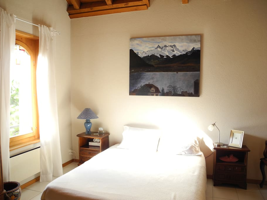 Guest bedroom with original painting of the Dents du Midi mts.