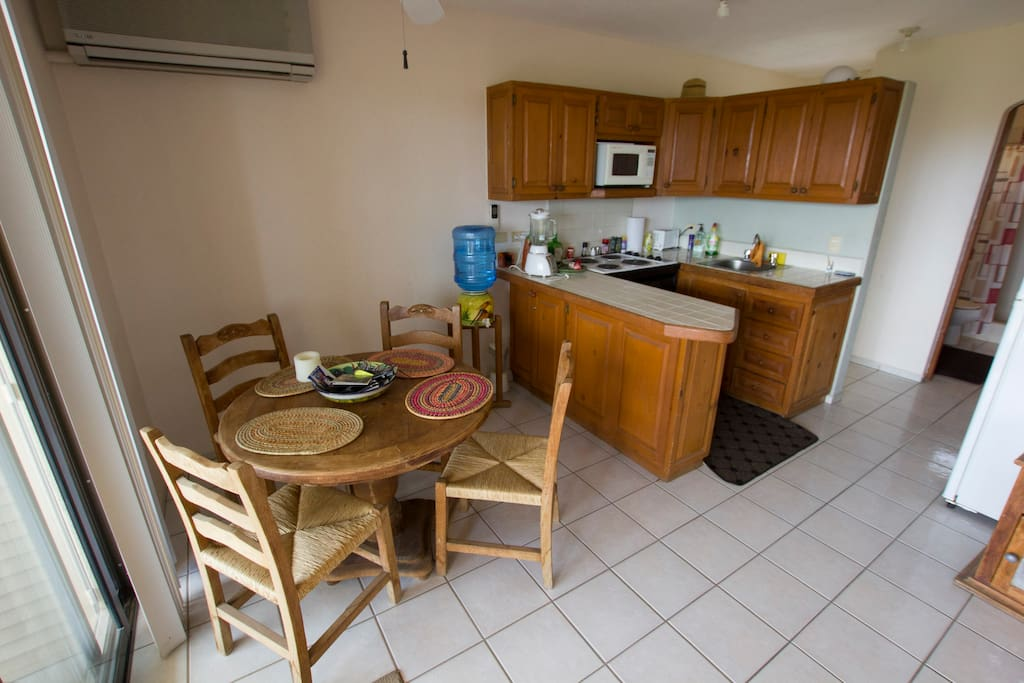 Fully equipped kitchen and dining area with A/C for those hot days!