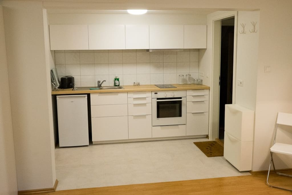 The kitchen - stove, refrigerator, oven and a microwave in the cupbord.  A expresso coffee maker for the stove.