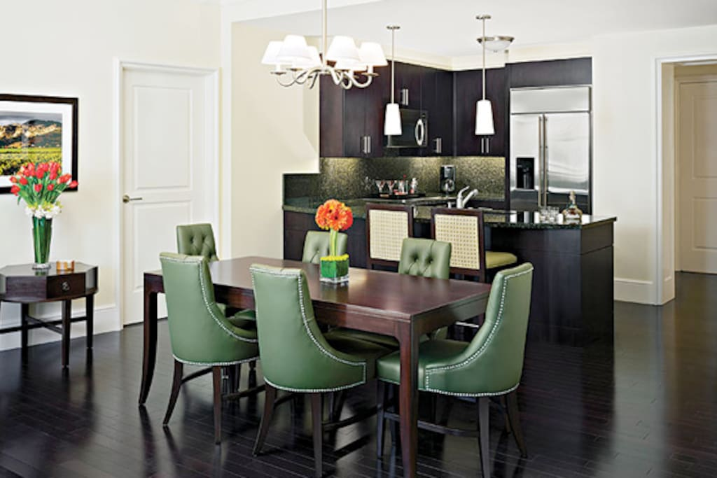 The gourmet kitchen and formal dining area in-unit