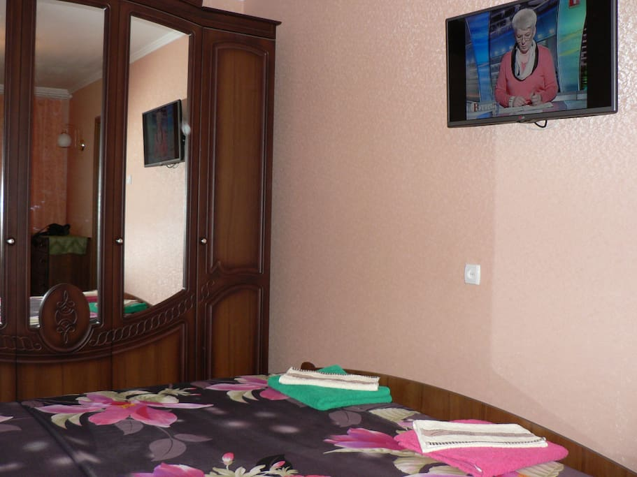 Clean bedroom with queen-size bed and flat tv. TV has more than 50 channels in russian and english. Also it is possible to watch you own video from usb pen drive.