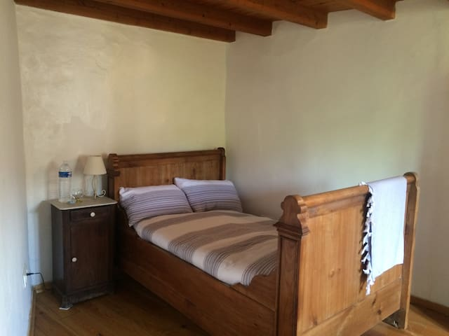 Traditional French 'double' bed - very cozy, better suited for lovebirds or singles.