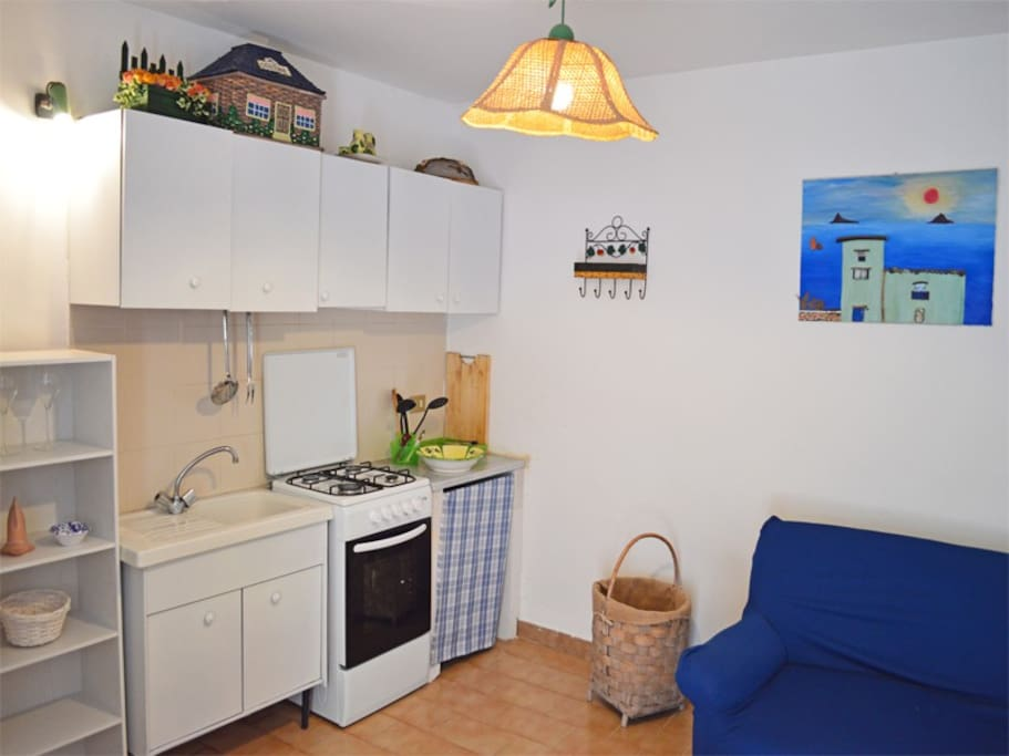 living room with kitchenette and sofabed