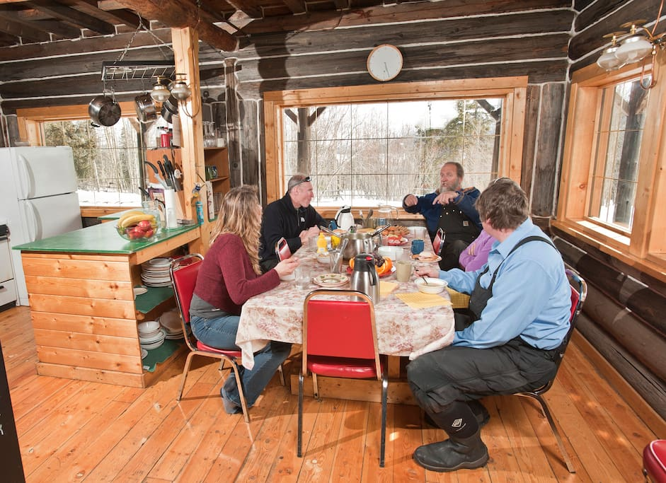 Shared dining room in the cozy Lodge. There's everything you need in the kitchen!