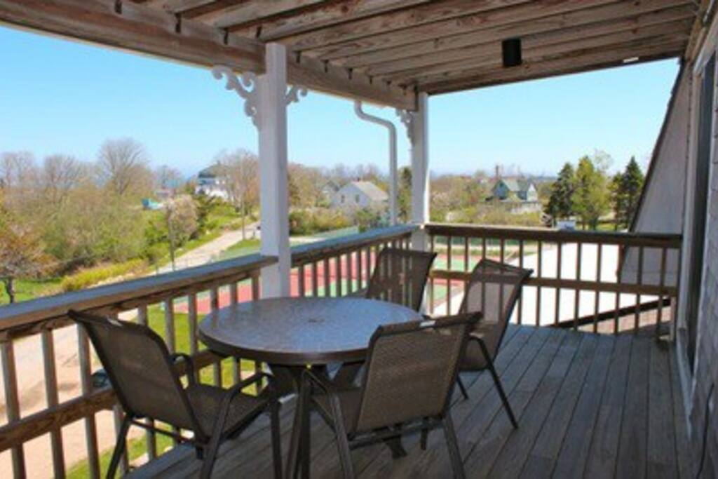 private porch overlooks tennis court