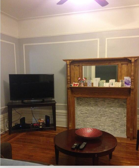 Living room has smart TV with cable + wireless internet + Blue Ray DVD player + ceiling fan + air conditioner