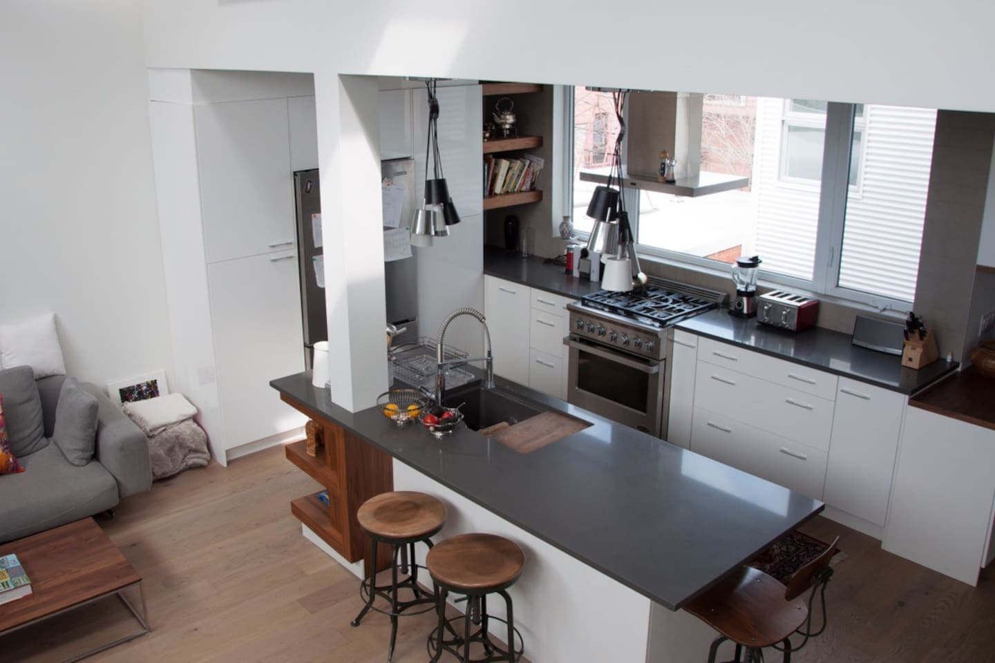 View of kitchen from mezzanine stairs