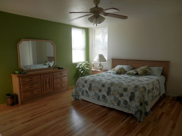 Mater bedroom with king size bed and new hickory hardwood floor