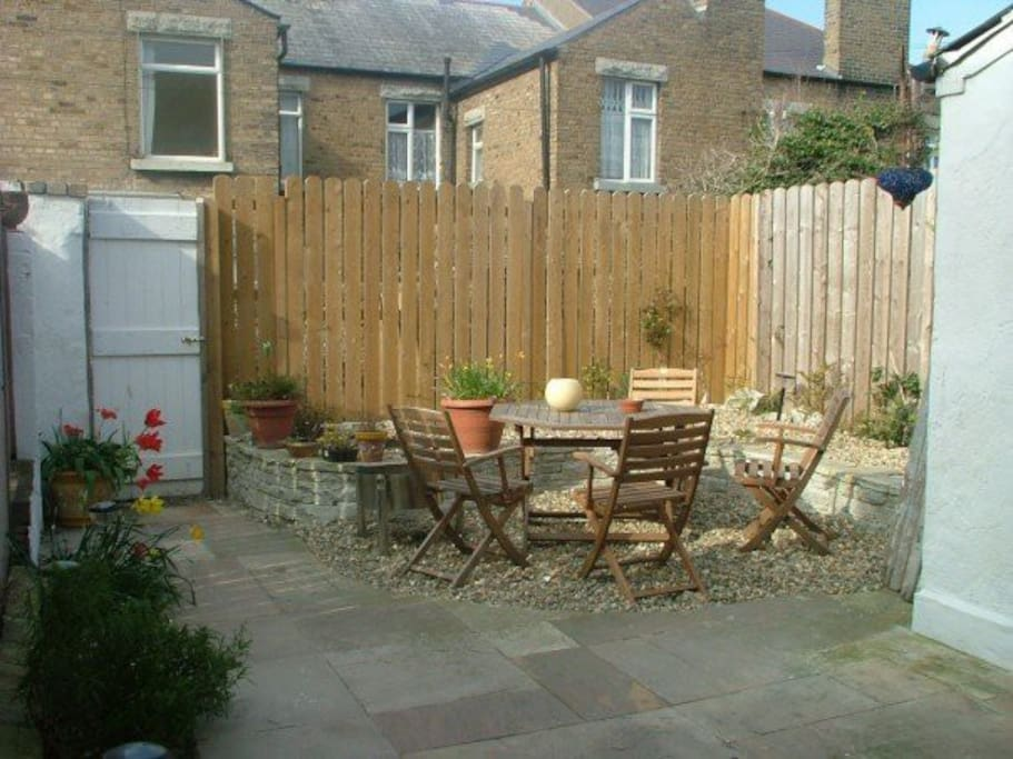 The backyard is a small area, ideal for a morning cup of coffee or a cigarette break