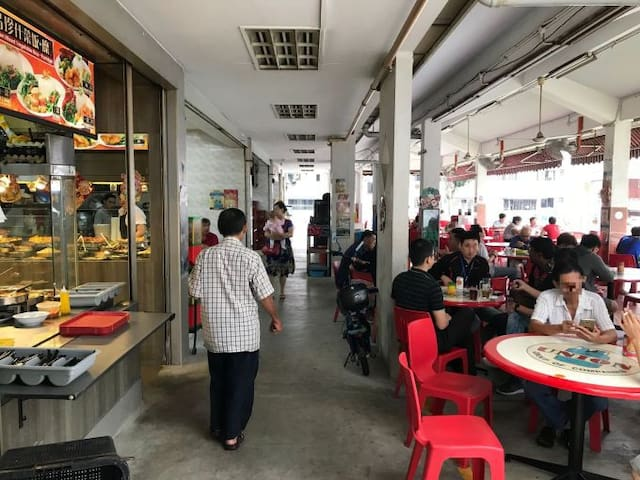 One of the many coffee shops with many hawker stalls serving delicious Singapore food at low prices within 1 to 5 minutes' walk from my apartment. You can find other shops and eateries nearby too.