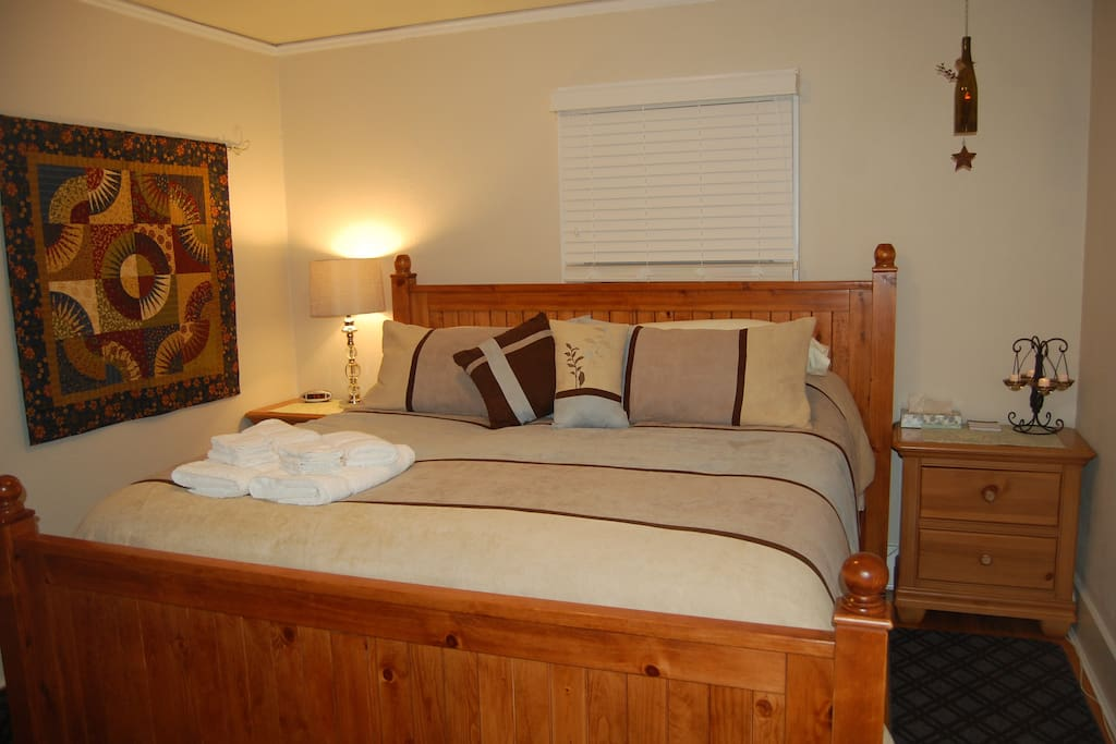 This pillow-top king sized bed will be hard to resist when you walk in the room!
