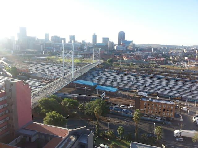 The famous Nelson Mandela Bridge with Johannesburg city skyline.