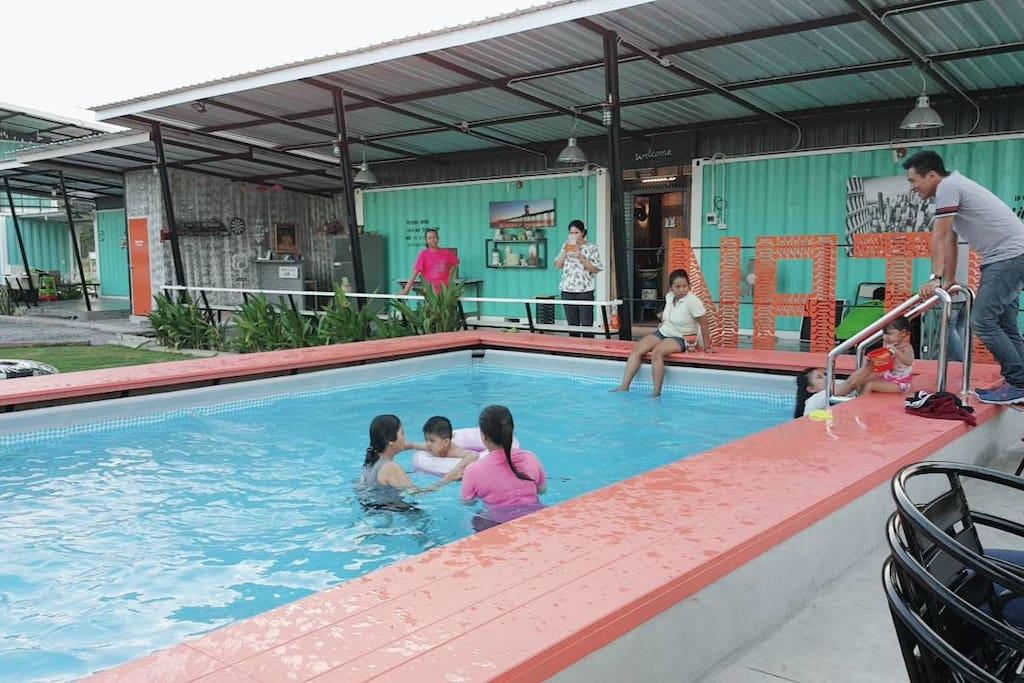 Kids enjoy the pool. Family fun.