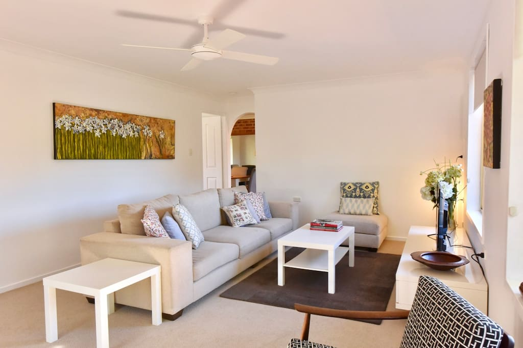 Living area is generous in size and bright.  Over head fan for hot days, gas heater for when its cool.