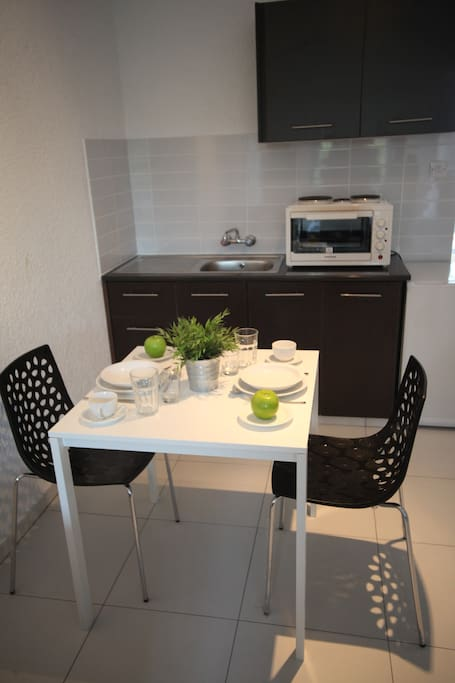 Dining Table with the kitchenette at the back