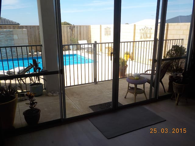 looking out to pool from  guests  lounge.