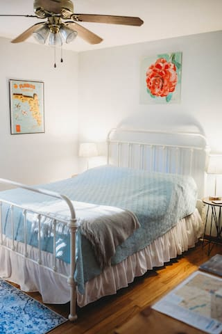 Here's another view of your bedroom. We provide freshly washed linens, quilts, and plenty of fresh towels for you to feel cozy and clean during your stay.
