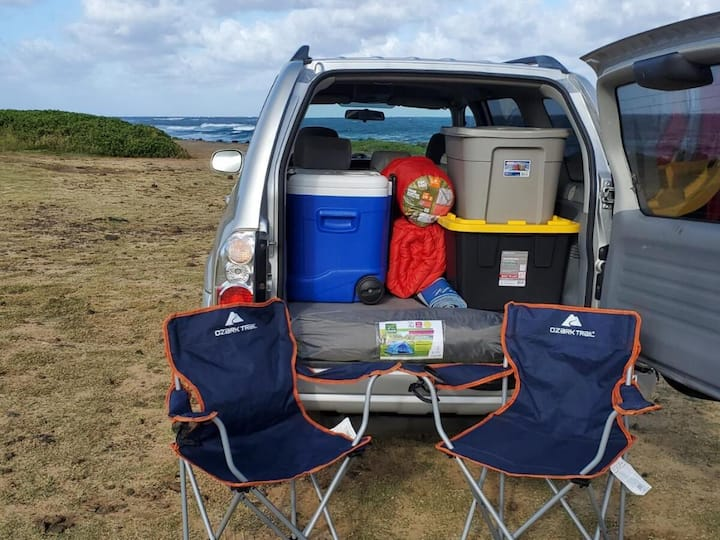 Sports SUV, full camping gear, private campsite