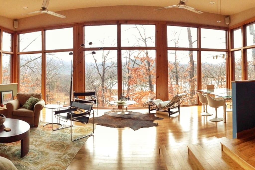 Primary living and dinning areas on upper level. Shown in fall to show lake below.